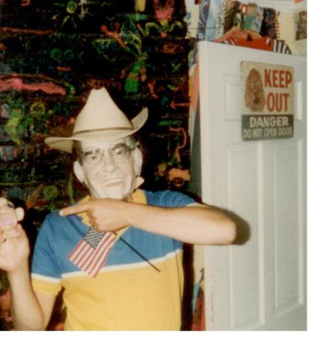 A figure with Nixon mask and toy.  The wall and a danger sign are in the background.  I don't think that that's me.